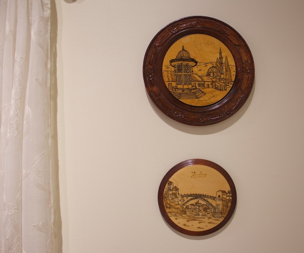 "These souvenir wall decorations depict two major cities in Bosnia, the larger depicting the Sebilj fountain in Sarajevo. The smaller shows the famous bridge of Mostart called ""Stari Most"" (""Old Bridge"")"